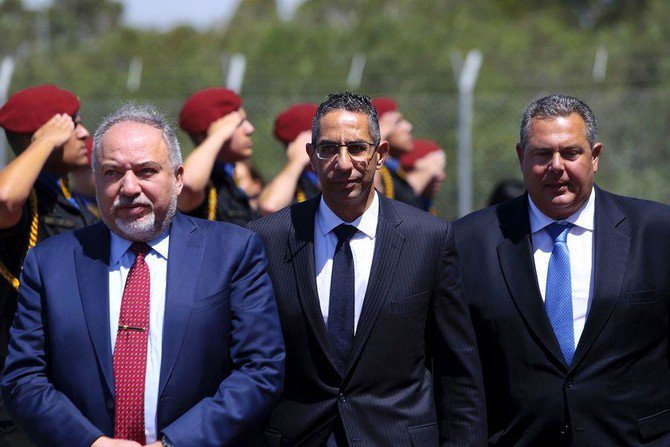 Israeli Defense Minister Avigdor Lieberman, left, Cypriot Defense Minister Savvas Angelides, center, and Greek Defense Mininister Panos Kammenos during trilateral talks in Larnaca, Cyprus, where Avigdor Lieberman suggested that Cyprus might be interested in building an Israeli-monitored port facility for the delivery of goods to the Gaza Strip. (AP Photo)