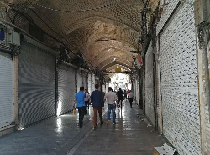 Iranian shop closed at the ancient Grand Bazaar in Tehran on June 25, 2018. Grand Bazaar shop owners closed their shops on monday in a rare strike movement to protest against the depreciation of the Iranian currency. / AFP / ATTA KENARE