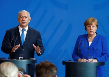 Israeli Prime Minister Benjamin Netanyahu gestures during a news conference with German Chancellor Angela Merkel in Berlin, Germany, June 4, 2018. REUTERS/Axel Schmidt