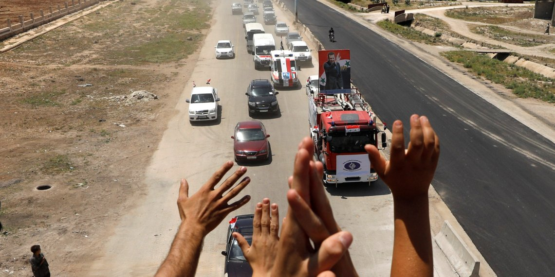 People celebrate the re-opening of the road between Homs and Hama in Talbisi, Syria, June 6, 2018. REUTERS/Omar Sanadiki