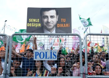 A supporter of Turkey's main pro-Kurdish Peoples' Democratic Party (HDP) holds a portrait of their jailed former leader and presidential candidate Selahattin Demirtas during a campaign event in Istanbul, Turkey, June 17, 2018. REUTERS/Huseyin Aldemir