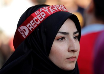 A supporter of Turkish President Tayyip Erdogan attends a pre-election gathering in Istanbul, Turkey, June 20, 2018. REUTERS/Huseyin Aldemir
