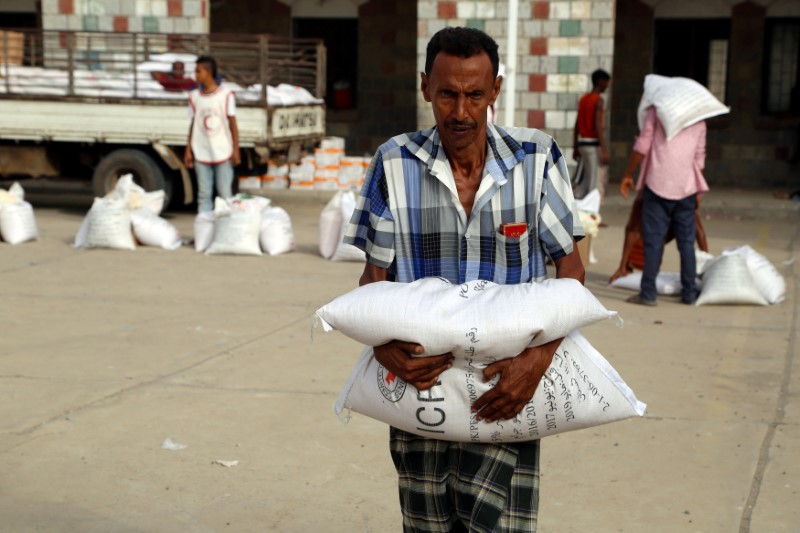A displaced man receives aid kits distributed by (ICRC) International Committee of the Red Cross in the war-torn Red Sea port city of Hodeidah, Yemen June 21, 2018. REUTERS/Abduljabbar Zeyad