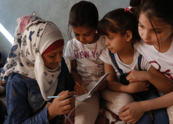 The orphanage first established in rebel-held eastern Aleppo, known as the Center for the Exceptional, has finally landed in a small house in the sleepy northern town of Jarablus. Above, Noor Ghanem, left, helps other Syrian orphans from Aleppo as they study at the orphanage. (AP)