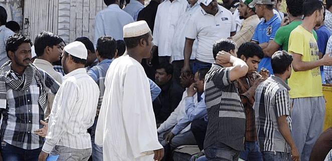 In this file photo, expatriate workers are seen outside a Labor Ministry office in Riyadh to fix their status in the Kingdom. In the past seven months, Saudi authorities have arrested more than 1.25 foreigners for violating residential and labor laws. (AFP)