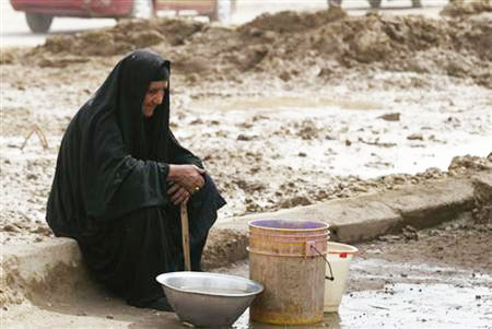 An Iraqi woman dealing with the water shortage. (Reuters)