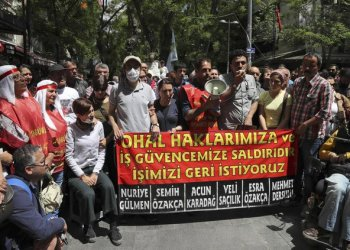 Former primary school teacher Semih Ozakca, fourth left, and Turkish academician Nuriye Gulmen, third left, during their 64th day of hunger strike on May 11, 2017, call on Turkish authorities to give back jobs to public employees who have been dismissed from their positions since the imposition of the state of emergency rule. (AFP)