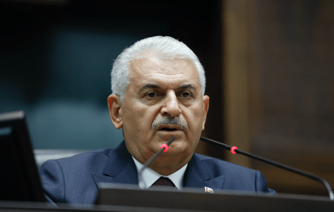 Binali Yildirim, former Turkey's Prime Minister and member of parliament from Izmir, with the ruling Justice and Development Party (AKP) listens to a speech by Turkey's President and party leader Recep Tayyip Erdogan at the parliament in Ankara, Turkey, Saturday, July 7, 2018. (AP)