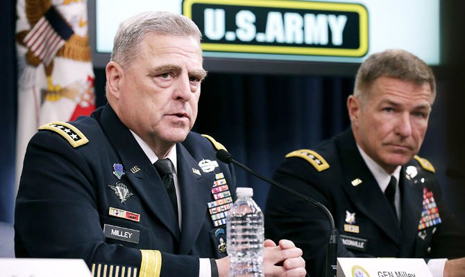 US Army Chief of Staff Gen. Mark Milley (L) and Army Vice Chief of Staff Gen. James McConville announce that Austin, Texas, will be the new headquarters for the Army Futures Command during a news conference at the Pentagon July 13, 2018 in Arlington, Virginia. (AFP)