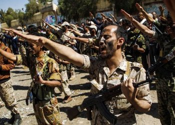 Newly recruited Houthi militants chant slogans during a gathering in the capital Sanaa to mobilize more fighters to battlefronts to fight pro-government forces in several Yemeni cities. (File Photo: AFP/Mohammed Huwais)