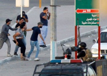 Above, members of the Iraqi security forces detain a protester on July 14 who took part in the week-long demonstrations to demand more jobs and better services. (AFP)