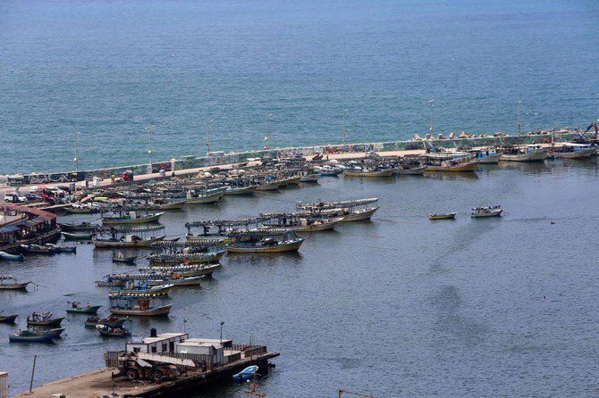 The fishing zone enforced by Israel off the Gaza Strip has been reduced from six nautical miles to three, while Israel has also tightened its blockade of the Strip, partly over the flying of kites carrying firebombs into its territory./ (AFP)