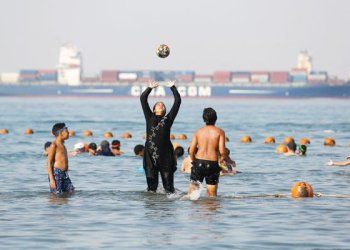 Holidaymakers play on Thursday at El-Sokhna beach in Suez, Egypt. (AP)