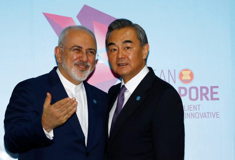 Iran's Foreign Minister Mohammad Javad Zarif and China's Foreign Minister Wang Yi shake hands at a bilateral meeting on the sidelines of the ASEAN Foreign Ministers' Meeting in Singapore, August 3, 2018. REUTERS/Feline Lim