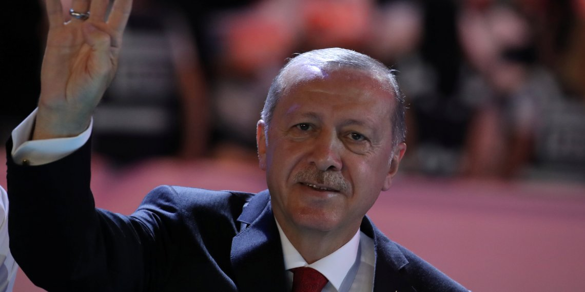 Turkish President Tayyip Erdogan greets his supporters during the sixth Congress of the ruling AK Party (AKP) in Ankara, Turkey, August 18, 2018. REUTERS/Umit Bektas