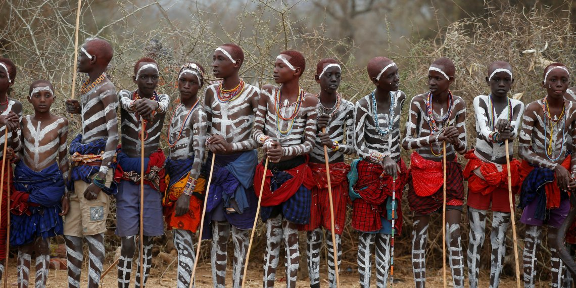 Maasai children part of the leaders' group stand during an initiation into an age group ceremony near the town of Bisil, Kajiado county, Kenya, August 23, 2018. Picture taken August 23, 2018. REUTERS/Baz Ratner