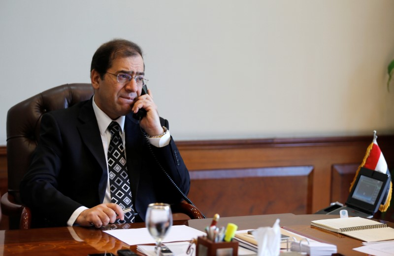 FILE PHOTO: Tarek El Molla, Egypt's Minister of Petroleum and Mineral Resources, speaks on the telephone during an interview with Reuters at his office in Cairo, Egypt, October 29, 2015. REUTERS/Amr Abdallah Dalsh