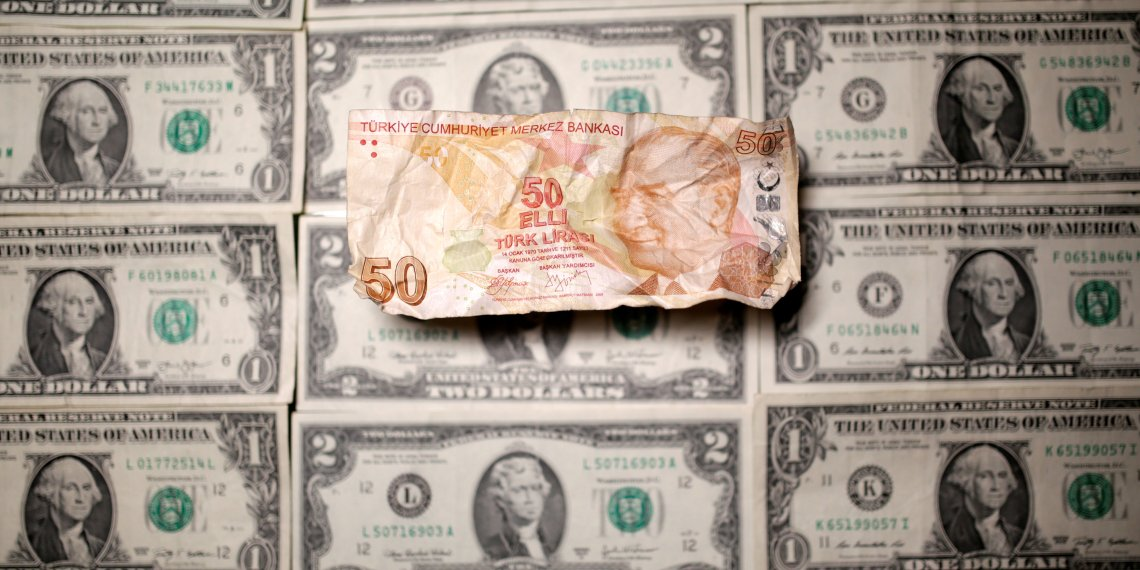 Turkish Lira and Dollar banknotes are seen in this picture illustration taken August 19, 2018. Picture taken August 19, 2018. REUTERS/Dado Ruvic/Illustration