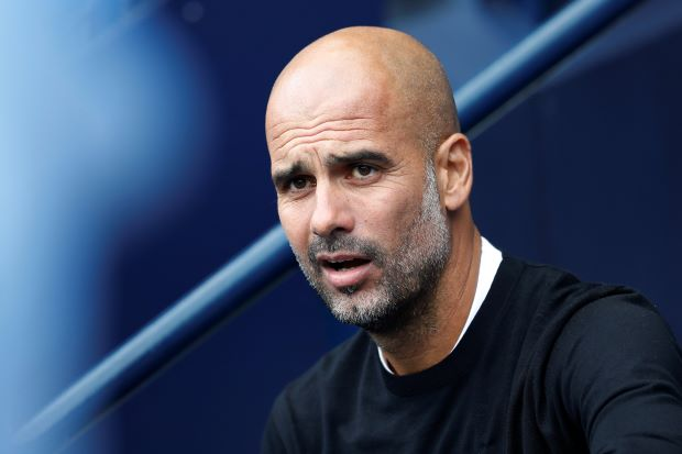 FILE PHOTO: Soccer Football - Premier League - Manchester City v Huddersfield Town - Etihad Stadium, Manchester, Britain - August 19, 2018 Manchester City manager Pep Guardiola before the match REUTERS/Darren Staples