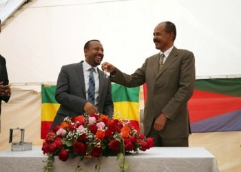 Eritrea's President, Isaias Afwerki receives a key from Ethiopia's Prime Minister, Abiy Ahmed during the Inauguration ceremony marking the reopening of the Eritrean Embassy in Addis Ababa, Ethiopia July 16, 2018. REUTERS/Tiksa Negeri