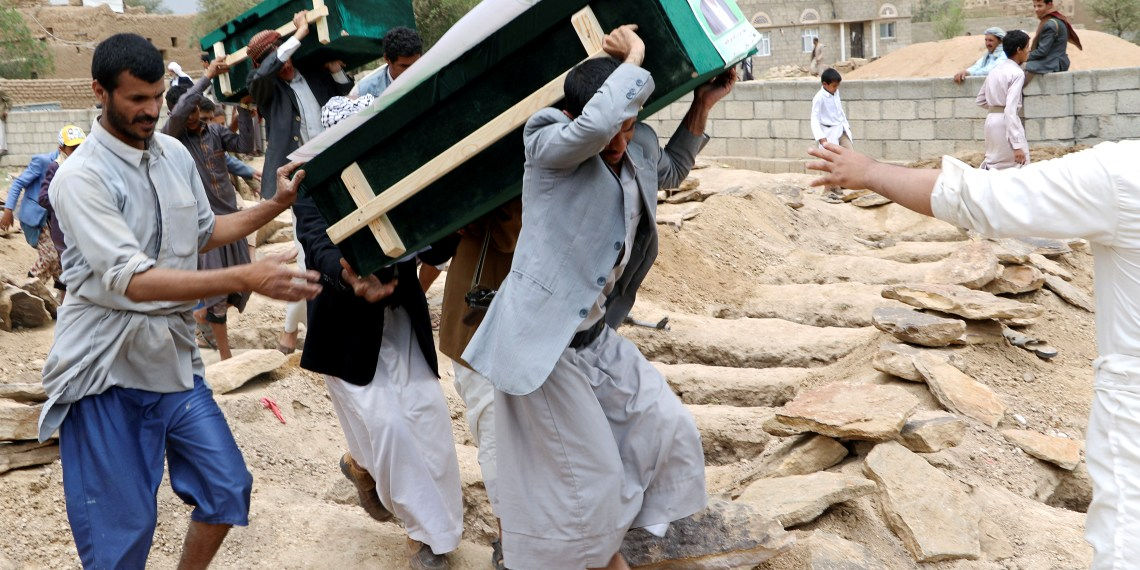 Mourners carry coffins during a funeral of people, mainly children, killed in a Saudi-led coalition air strike on a bus in northern Yemen, in Saada, Yemen August 13, 2018. REUTERS/Naif Rahma
