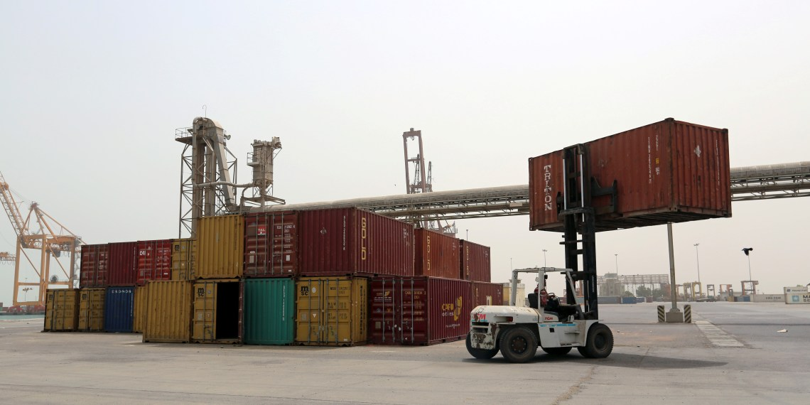 FILE PHOTO: A forklift carries a shipping container at the Red Sea port of Hodeidah, Yemen June 24, 2018. REUTERS/Abduljabbar Zeyad