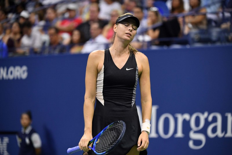 Sep 3, 2018; New York, NY, USA; Maria Sharapova of Russia reacts after losing a point to Carla Suarez Navarro of Spain in a fourth round match on day eight of the 2018 U.S. Open tennis tournament at USTA Billie Jean King National Tennis Center. Mandatory Credit: Danielle Parhizkaran-USA TODAY Sports