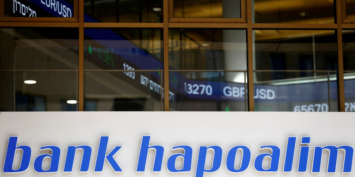 FILE PHOTO: The logo of Bank Hapoalim, Israel's biggest bank, is seen at their main branch in Tel Aviv, Israel July 18, 2016. REUTERS/Amir Cohen/File Photo
