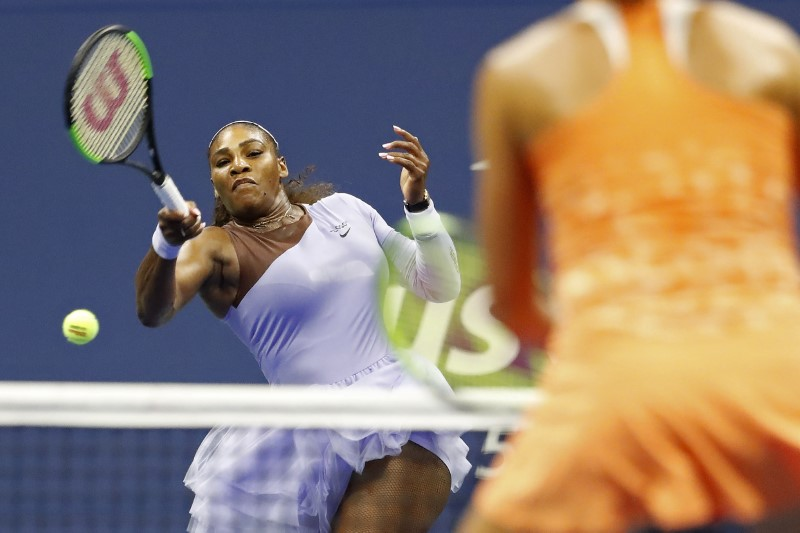 Sep 6, 2018; New York, NY, USA; Serena Williams of the United States hits a forehand against Anastasija Sevastova of Latvia (R) in a women's semi-final match on day eleven of the 2018 U.S. Open tennis tournament at USTA Billie Jean King National Tennis Center. Mandatory Credit: Geoff Burke-USA TODAY Sports