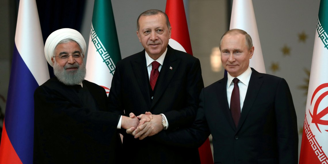 FILE PHOTO: Presidents Hassan Rouhani of Iran, Tayyip Erdogan of Turkey and Vladimir Putin of Russia pose before their meeting in Ankara, Turkey April 4, 2018. Tolga Bozoglu/Pool via Reuters/File Photo