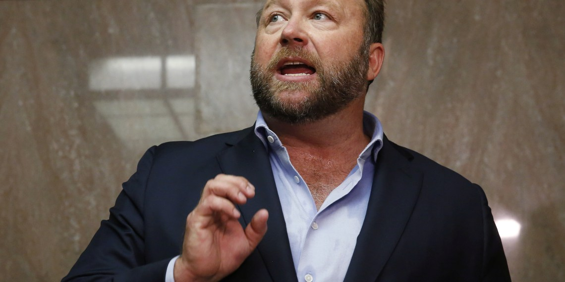 FILE PHOTO - Alex Jones of Infowars talks to the media while visiting the U.S. Senate's Dirksen Senate office building as Twitter CEO Jack Dorsey testifies before a Senate Intelligence Committee hearing on Capitol Hill in Washington, U.S., September 5, 2018. REUTERS/Jim Bourg