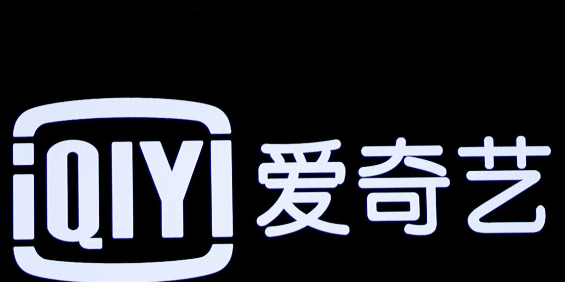 The logo for Chinese streaming platform iQiyi Inc., is displayed on a screen during the company's initial public offering (IPO) at the Nasdaq Market Site in New York City, U.S., March 29, 2018. REUTERS/Brendan McDermid