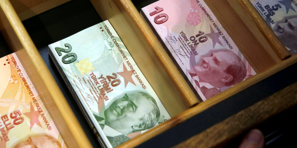 FILE PHOTO: Turkish lira banknotes are pictured at a currency exchange office in Istanbul, Turkey August 13, 2018. REUTERS/Murad Sezer/File Photo