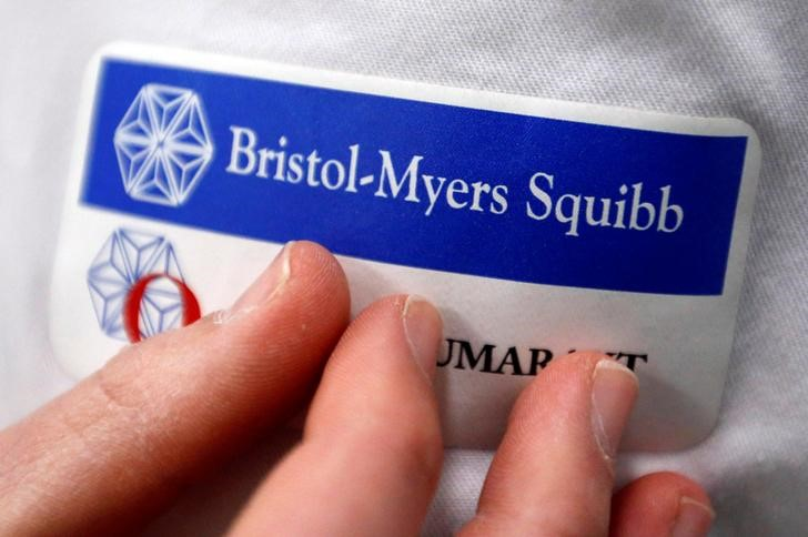 FILE PHOTO: Logo of global biopharmaceutical company Bristol-Myers Squibb is pictured on the blouse of an employee in Le Passage, near Agen, France March 29, 2018. REUTERS/Regis Duvignau