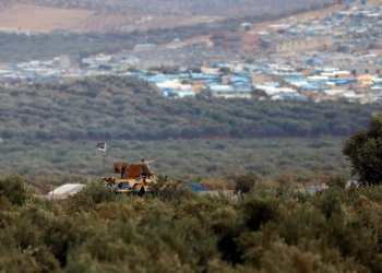 FILE PHOTO: A Turkish military armoured vehicle guards on the border line located opposite the Syrian town of Atimah, Idlib province, in this picture taken from Reyhanli, Hatay province, Turkey October 10, 2017. REUTERS/Osman Orsal/File Photo