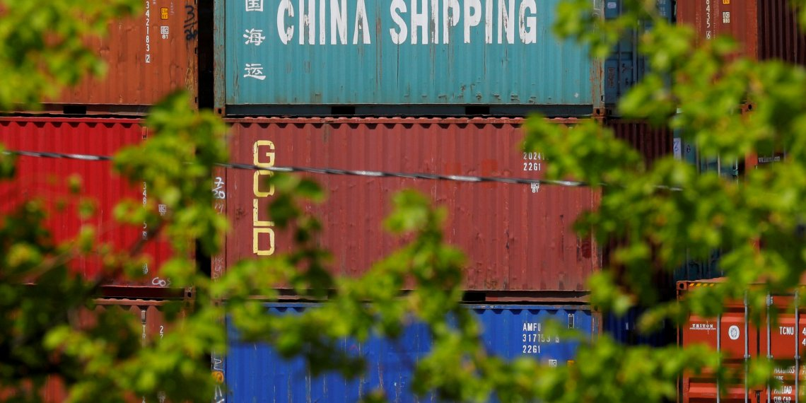 """FILE PHOTO: Shipping containers, including one labelled """"China Shipping,"""" are stacked at the Paul W. Conley Container Terminal in Boston, Massachusetts, U.S., May 9, 2018. REUTERS/Brian Snyder/File Photo"""