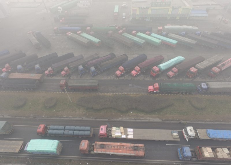 FILE PHOTO: Trucks are seen stranded near a highway during a polluted day in Shijiazhuang, Hebei province, China December 20, 2016. REUTERS/Stringer