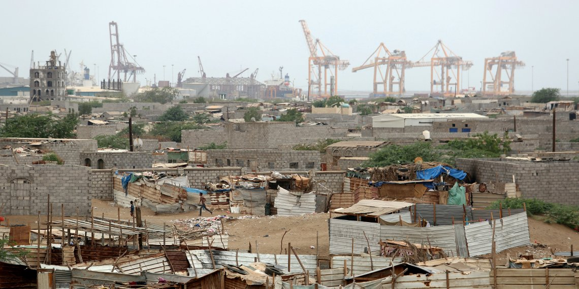 FILE PHOTO: Hodeidah port's cranes are pictured from a nearby shantytown in Hodeidah, Yemen June 16, 2018. REUTERS/Abduljabbar Zeyad/File Photo