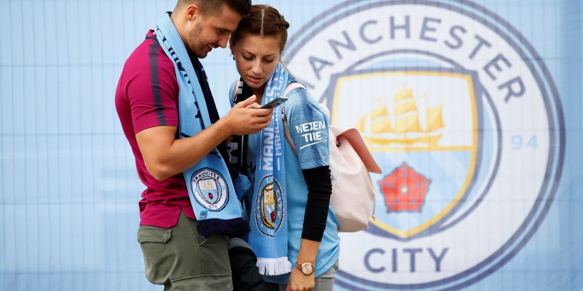 Soccer Football - Premier League - Manchester City v Fulham - Etihad Stadium, Manchester, Britain - September 15, 2018 Manchester City fans outside the stadium before the match Action Images via Reuters/Jason Cairnduff
