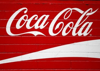 FILE PHOTO: The logo of Dow Jones Industrial Average stock market index-listed company Coca-Cola (KO) is seen in Los Angeles, California, U.S. April 4, 2016. REUTERS/Lucy Nicholson/File Photo