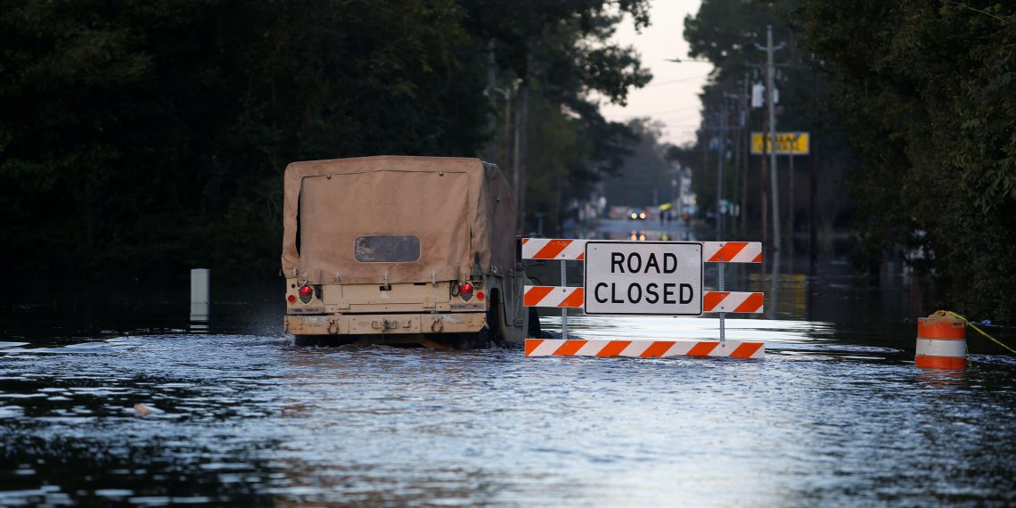 The National Guard navigates through flood waters in the aftermath of Hurricane Florence in Fair Bluff, North Carolina, U.S. September 18, 2018. REUTERS/Randall Hill