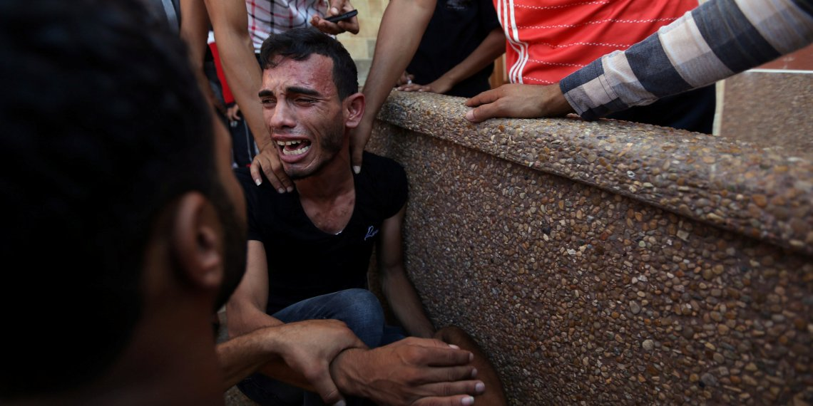 A relative of Palestinians who were killed at the Israel-Gaza border, reacts in the southern Gaza Strip September 18, 2018. REUTERS/Ibraheem Abu Mustafa