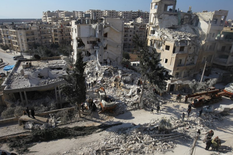 FILE PHOTO: People inspect the damage at a site hit by airstrikes in the rebel-held city of Idlib, Syria February 7, 2017. REUTERS/Ammar Abdullah