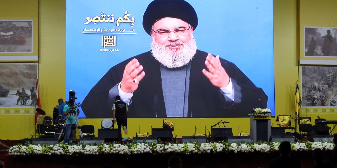 FILE PHOTO: Lebanon's Hezbollah leader Sayyed Hassan Nasrallah gestures as he addresses his supporters via a screen in Beirut, Lebanon August 14, 2018. REUTERS/Aziz Taher