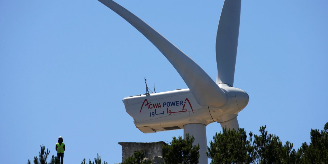 FILE PHOTO: A Saudi Acwa Power-generating windmill is pictured in Jbel Sendouq, on the outskirts of Tangier, Morocco, June 29, 2018. REUTERS/Youssef Boudlal/File Photo