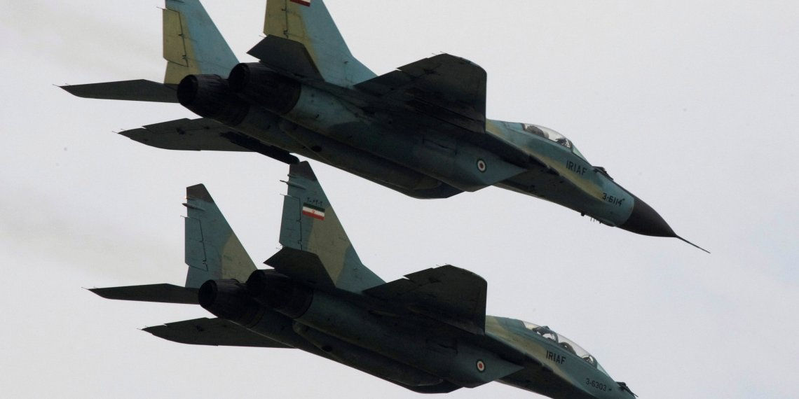 FILE PHOTO: Russian-made Sukhoi fighter jets of the Iranian army fly past during a military parade to commemorate army day in Tehran April 17, 2008.  REUTERS/Morteza Nikoubazl/File Photo