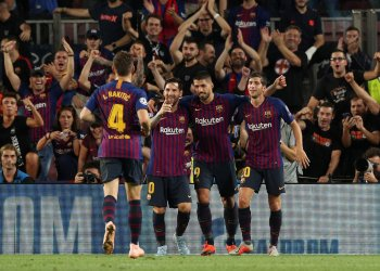 Soccer Football - Champions League - Group Stage - Group B - FC Barcelona v PSV Eindhoven - Camp Nou, Barcelona, Spain - September 18, 2018 Barcelona's Lionel Messi celebrates with Luis Suarez, Sergi Roberto and Ivan Rakitic after scoring their third goal REUTERS/Albert Gea
