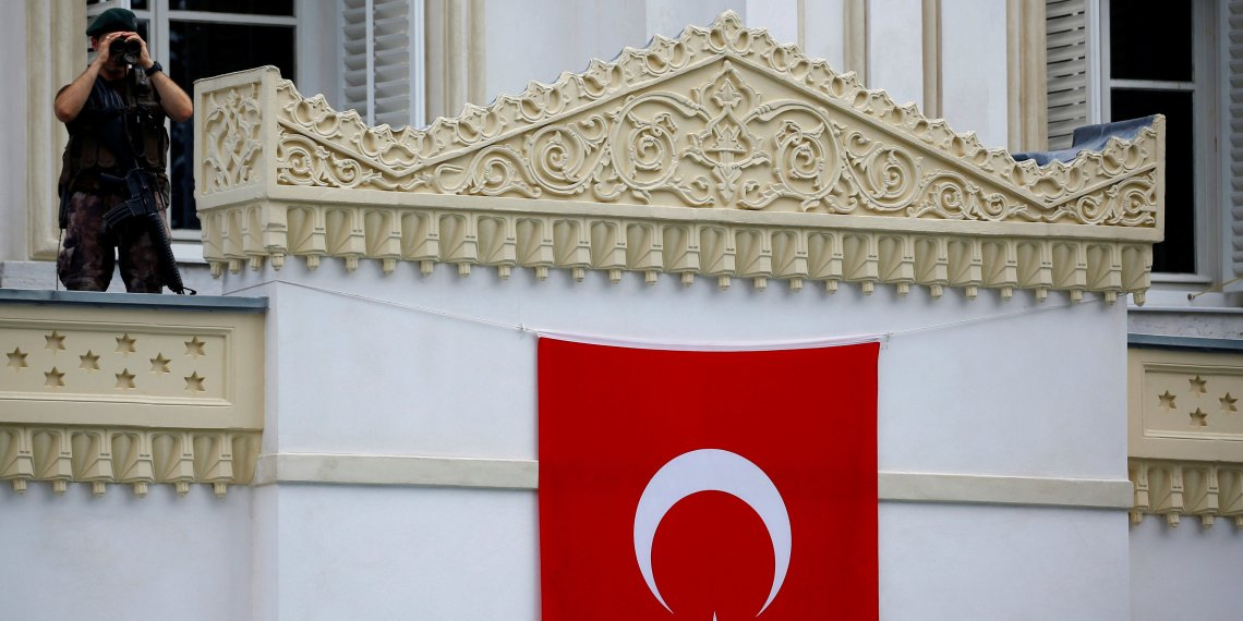 FILE PHOTO: A member of police special forces stands guard as Turkish President Tayyip Erdogan attends the re-opening of the Ottoman-era Yildiz Hamidiye mosque in Istanbul, Turkey, August 4, 2017. REUTERS/Murad Sezer/File Photo