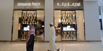 FILE PHOTO - Locals are seen passing in front of a high-end watch boutique Audemars Piguet in Moda Mall in Manama, Bahrain, January 26, 2018. REUTERS/Hamad I Mohammed