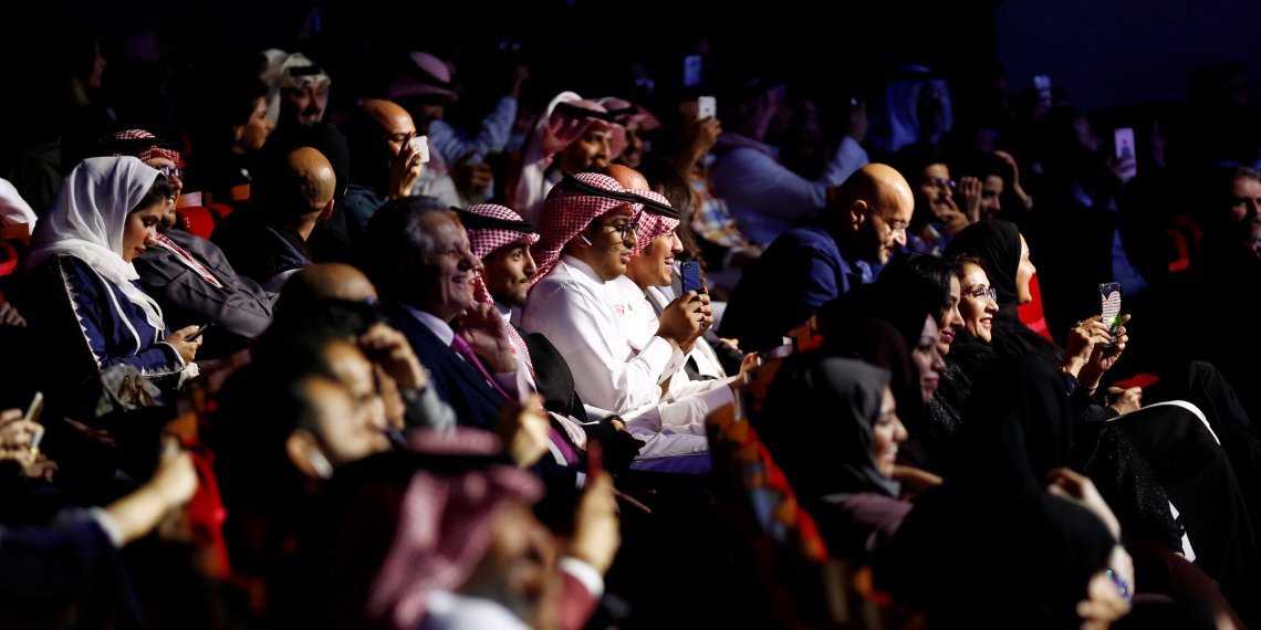 FILE PHOTO: Saudi people attend the concert of composer Yanni at Princess Nourah bint Abdulrahman University in Riyadh, Saudi Arabia December 3, 2017. REUTERS/Faisal Al Nasser/File Photo